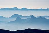 Foggy mountain range, Al Hajar, Jebel Shams, Oman