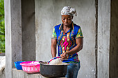 Woman preparing Cassava based Fufu dough, Ganta, Liberia