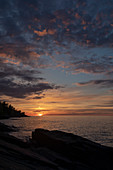 Sunset over Lake Superior shoreline