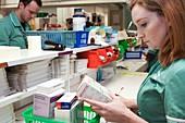 Pharmacy technician checking a prescription