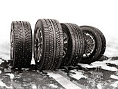 Car tyres rolling on a snow-covered road, illustration