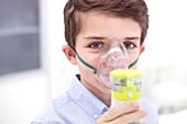 Boy using nebuliser
