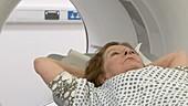 Patient sliding into a PET CT scanner