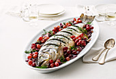 Oven-roasted herb trout with onions and grapes