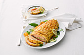 Salmon fillets with herb sauce wrapped in puff pastry