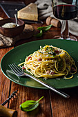 Spaghetti with herb butter, bacon and parmesan