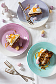 Easter carrot cake slices decorsted with mini eggs and candied orange peel