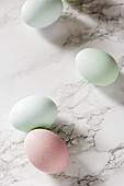 Natural Pastel dyed Easter eggs on marble