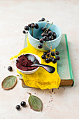 Aronia berries and powder on a book