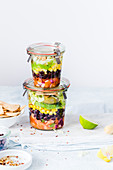 Layered Mexican salads in jars