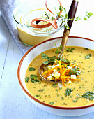 Cream of potato soup with chervil and vegetables