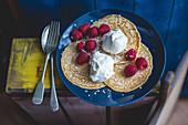 Pancakes with coconut icecream and raspberries