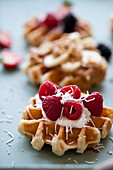 Waffled topped with raspberries, vanilla yogurt and coconut