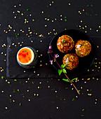 Sesame and tofu balls with sweet chili sauce