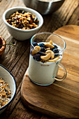 Healthy breakfast - screals with fruit and yogurt with seeds