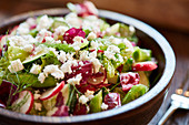 A mixed salad with radishes, cucumber, celery and feta cheese