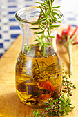 Homemade Mediterranean olive oil with herbs and chilli