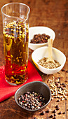 Homemade savory spice oil in a glass carafe