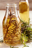 Homemade rosemary vinegar in a glass bottle