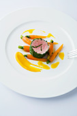 Poached pork fillet in a herb coat with carrots