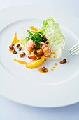 Crayfish with salad, chanterelles and glazed peaches