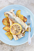 Pan seared garfish fillets with skin with crispy potato slices