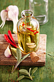 Homemade sage oil with red chilli and garlic