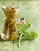 Homemade vinegar with fresh rue and white wine vinegar