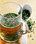 Homemade herb vinegar with fresh rosemary, parsley and wine vinegar