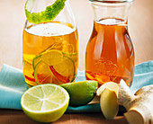 Ginger vinegar and ginger-lime oil in two bottles