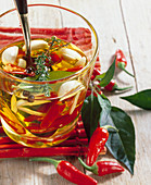 Fiery and spicy olive oil with chili, garlic, thyme, laurel and allspice