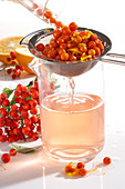 Homemade rowan berry vinegar with orange zest