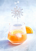 Campari orange with fruit slice and ice cubes (Christmas)