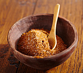 Jerk (seasoning mix, Caribbean) with a spoon in a wooden bowl