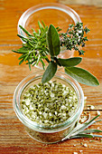 Homemade herb salt with sage, rosemary and thyme