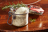 Homemade rosemary sugar in a glass jar