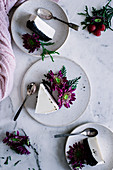 Plates with cake and flowers