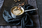 Creamy cauliflower soup with almonds