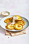 Apple pancakes with quark cream and sugar pearls