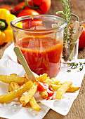 Homemade tomato and chili ketchup in a glass for french fries