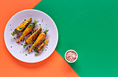 Healthy roasted carrots on colorful background