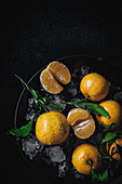 Fresh tangerines in season on dark background