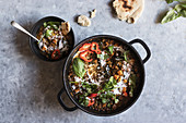 Bowl near pot with ragout of lentil and sweet potato curry