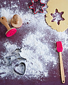 Dough for Christmas biscuits, cutters, stamps and a brush