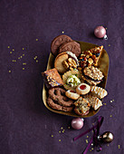 Various Christmas biscuits in a gold dish