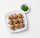 Red cabbage and bread dumplings on sour cream with chives