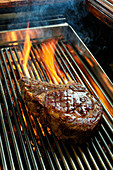 Ribeye steak on a flaming grill