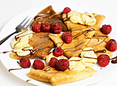 Crepes with raspberries and bananas