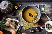 Vegan pumpkin soup with cripy sage leaves as a garnish