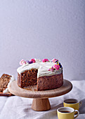 Carrot, banana and beetroot cake with honey and yoghurt icing